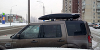 Land Rover Discovery 4 c боксом Thule Dynamic 800